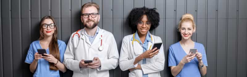 doctors and nurses using mobile devices